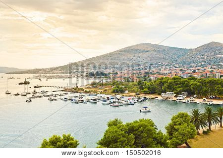 Trogir is a historic UNESCO town and harbour on the Adriatic coast and a popular tourist destination