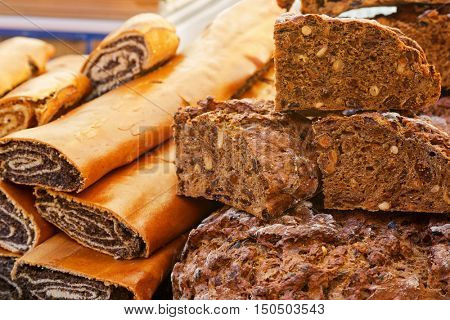 Closeup of Austrian poppy seed strudel (Mohnstrudel) and dried pear fruit cake bread (Kletzenbrot) in South Tyrol