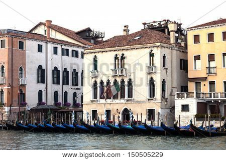 VENICE - 27 JUNE 2014: Gondolas outside appartments on 27 June 2014 in Venice, Italy. Editorial use only.
