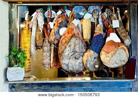 many of hanging Italian meat delicacies in Rome