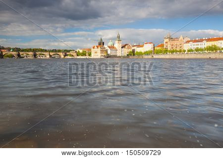 View from Strelecky island on the Novotny footbridge next the Charles Bridge in Prague. Photographed close above the Vltava river.
