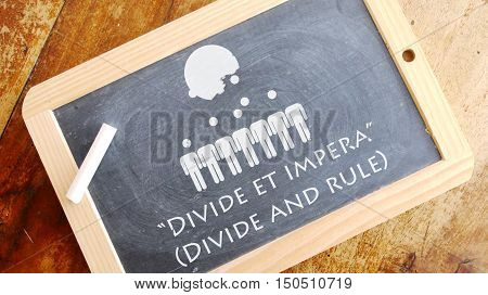 Divide et impera. A Latin phrase that means Divide and rule.