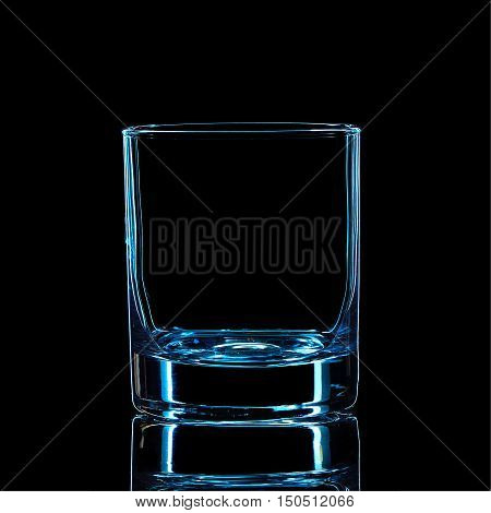 Silhouette of blue strong liquor classic glass with clipping path on black background.
