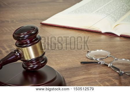 Judge gavel and old books