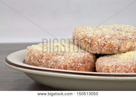 The raw patties made from minced meat before frying. White background. Patties.