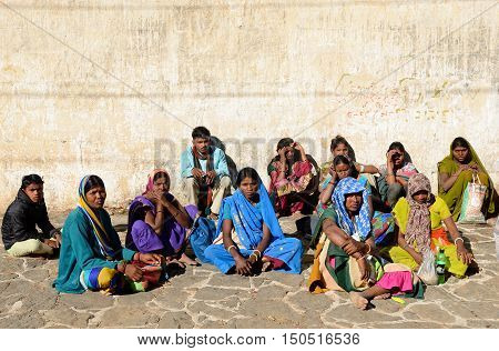 JUNAGADH GUJARAT INDIA - JANUARY 18: Group of Indian pilgrims resting in transit to the Temple complex on the holy Girnar top in Gujarat state in IndiaJunagadh in January 18 2015