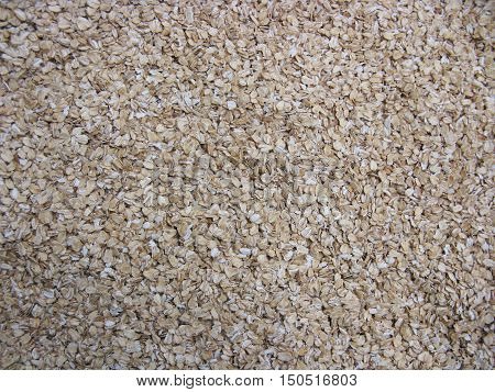 Dry cereal (rolled oats, oatmeal, oat flakes). Oatmeal background. Natural background. Food background.