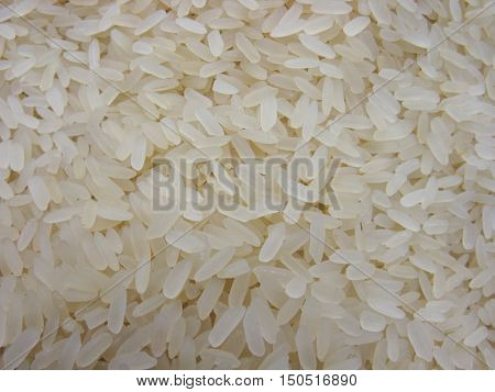 Dry rice. Rice background. A lot of dry rice (rice cereal). Scattered rice. Natural background.