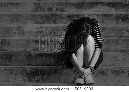 Unemployed Beautiful woman in frustrated depression. Conceptual of sadness and problems human in dark tone