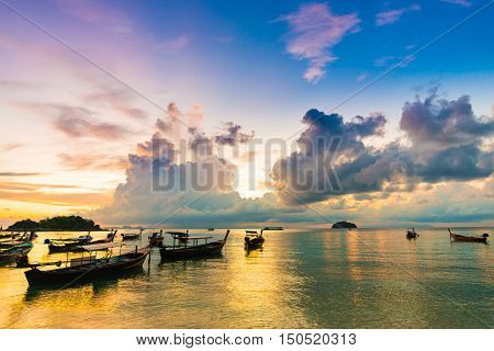 The Fishing And Travel Boat Toward The Sun Light At Sunrise At Lipe Island