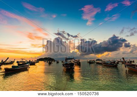 Reflection Of Wooden Boat With Burning Sky During Sunrise