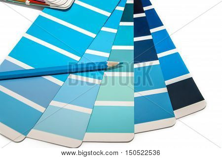 Color swatches book with color pencil on white background