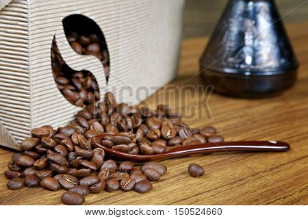 Coffee Beans Spill Out Of The Box On The Table