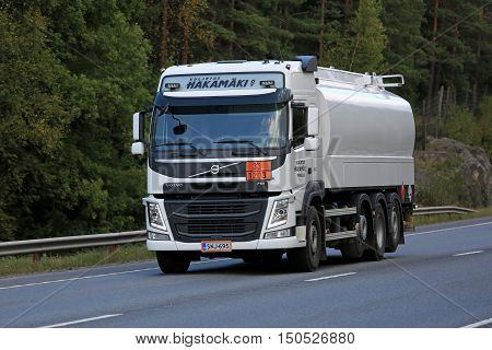 ORIVESI, FINLAND - SEPTEMBER 1, 2016: White Volvo FM tank truck of Kuljetus Hakamaki Oy on the road. The ADR code 33-1203 signifies gasoline.