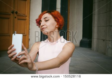 Portrait Of A Girl Doing Selfie. Girl In Light Pink Dress With Red Dyed Hair, Pictures Of Themselves