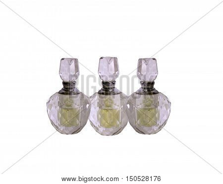 A clear photograph of three imperfectly shaped cut crystal glass perfume bottles - whites neutralised by means of lens/filter