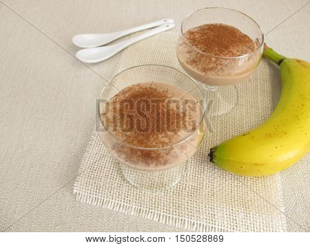 Homemade chocolate ice cream dessert with frozen bananas and cocoa