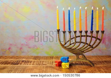 Menorah with candles and dreidel for Hanukkah celebration