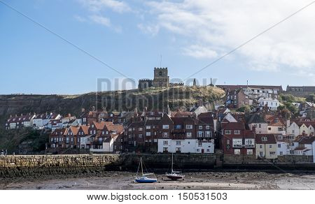 View across the harbour at Whitby to St Mary's Church Yorkshire UK