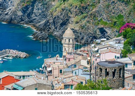 Colorful facades of the old houses in the village Vernazza. Church of St. Margaret of Antioch. Cinque Terre National Park, Liguria, Italy.