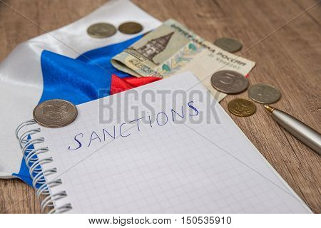 sanctions of russia - paper, coins, money and pen