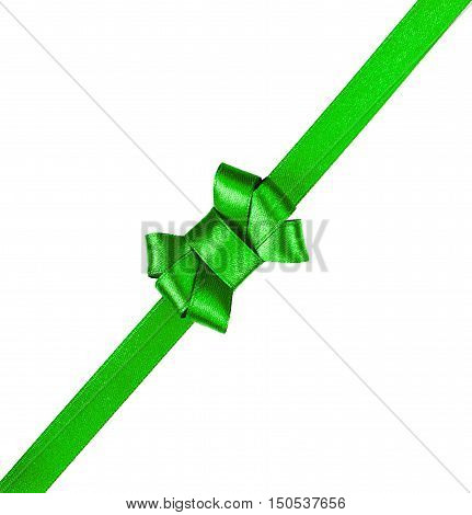 Green satin ribbon tied in a bow isolated on white background. Packaging and decoration for holiday gift or present.