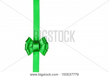 Green satin ribbon tied in a bow isolated on white background. Packaging and decoration for holiday gift or present concept.