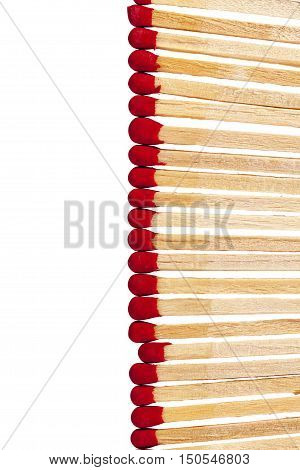 composition of matches with rad heads isolated on white background close up