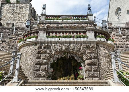 RAPPERSWIL SWITZERLAND - MAY 10 2016: Fountain in the form of the cave it is decoration of the stairway leading from the city square to the castle