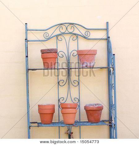 Empty terracotta garden pots on a table