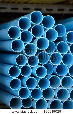 close up blue pvc pipes in store