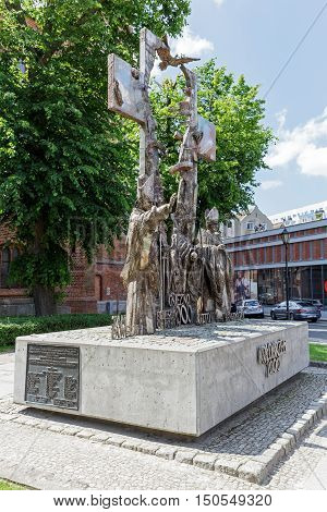 KOLOBRZEG POLAND - JUNE 23 2016: Millennium Memorial that was made of stainless steel and it was unveiled in 2000 years then enlarged in 2008 it is located next to Basilica in downtown