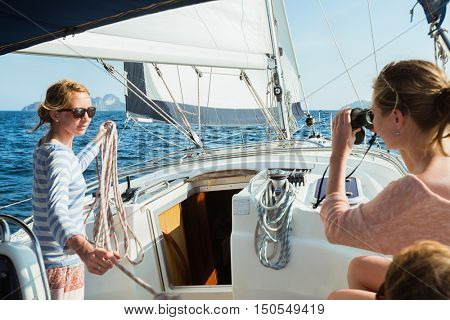 Young women on the sailing boat
