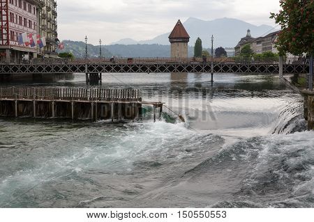 LUCERNE SWITZERLAND - MAY 11 2016: Needle Dam in the river Reuss. Weir was designed to use of thin wooden needles that can be added or removed by hand to maintain the level of water in Lake Lucerne