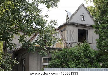 ZAKOPANE POLAND - SEPTEMBER 23 2016: The roof of the brick villa during the renovation or demolition. This villa that is named Monte was built in 1925