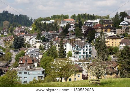 LUCERNE SWITZERLAND - MAY 04 2016: Aerial view towards residential buildings among them a lot of greenery it can be seen as an attractive tourist destination