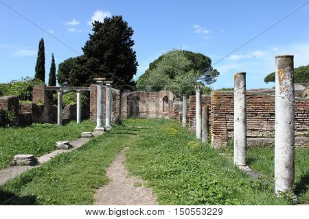 Columns of an ancient roman temple in Ostia Antica the old harbour of Rome Italy