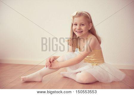 Smiling Pretty Ballet Girl In White Tutu In Studio