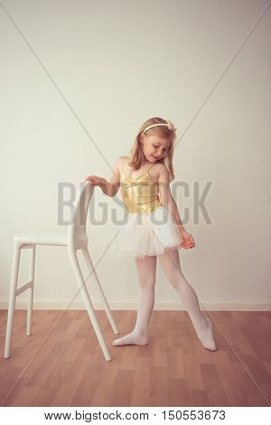 Smiling Pretty Ballet Girl In White Tutu Practicing A Dance Number