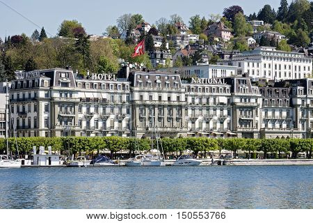 LUCERNE SWITZERLAND - MAY 05 2016: The Grand Hotel National front facade overlooks the lakeside promenade along Nationalquai the hotel was opened in 1870