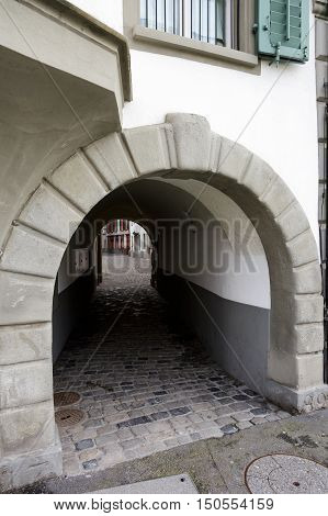 LUCERNE SWITZERLAND - MAY 02 2016: The narrow passage between the two streets of the old town shows the tourist attractiveness of the city and a multitude of attractions for visitors