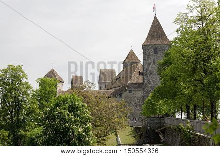 RAPPERSWIL SWITZERLAND - MAY 10 2016: The Castle during overcast day. It was built in the early 13th century. The castle became the seat of the Polish National Museum since 1870