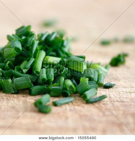 Freshly chopped fragrant chives in a horizontal composition