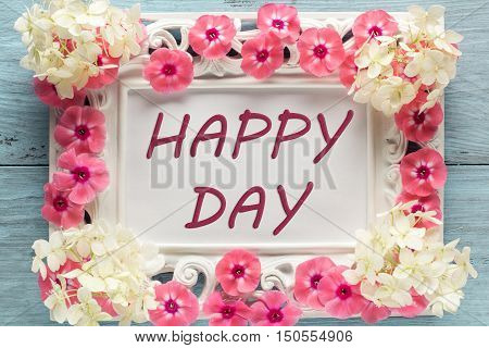 Caption: happy day framed with flowers. Closeup