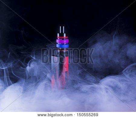 E-cigarette mod in smoke on black background