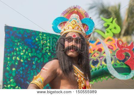 DHAKA BANGLADESH- AUGUST 25 2016 A man in a dev character in janmashtami festival