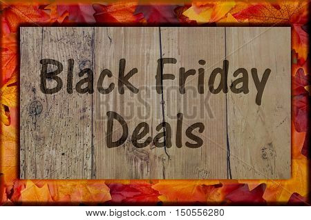 Black Friday Shopping Deals Autumn Leaves Frame with Weathered wood background with text Black Friday Deals 3D Illustration