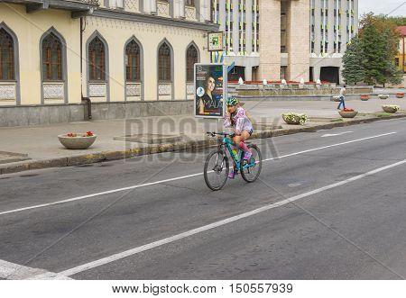 DNEPR, UKRAINE - AUGUST 24, 2016: Lonely cyclist on Yavornytskyi Avenue at summer weekend in Dnepr city Ukraine at August 24, 2016