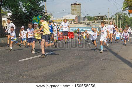 DNEPR UKRAINE- AUGUST 24, 2016: Kids running in Vyshyvanka Run during Independence Day local activity in Dnepr Ukraine at August 24 2016