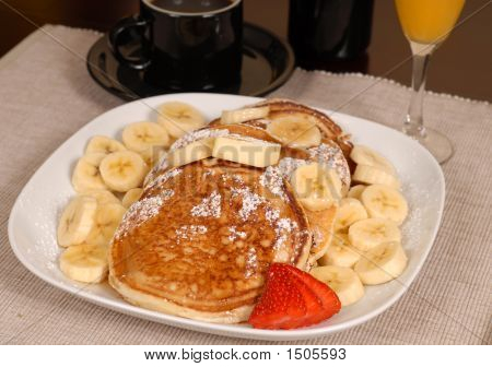 Banana Pancakes With Coffe And Orange Juice